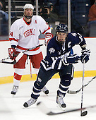 Riley Nash (Cornell - 14), Bobby Butler (UNH - 12) - The University of New Hampshire Wildcats defeated the Cornell University Big Red 6-2 (EN) on Friday, March 26, 2010, in their NCAA East Regional semi-final at the Times Union Center in Albany, New York.