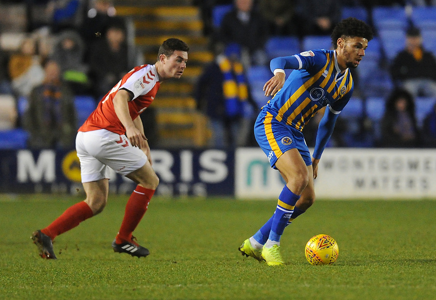 Shrewsbury Town's Lee Angol under pressure from Fleetwood Town's Nathan Sheron<br /> <br /> Photographer Kevin Barnes/CameraSport<br /> <br /> The EFL Sky Bet League One - Shrewsbury Town v Fleetwood Town - Tuesday 1st January 2019 - New Meadow - Shrewsbury<br /> <br /> World Copyright © 2019 CameraSport. All rights reserved. 43 Linden Ave. Countesthorpe. Leicester. England. LE8 5PG - Tel: +44 (0) 116 277 4147 - admin@camerasport.com - www.camerasport.com