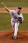 24 June 2004: Montreal Expos right-hander Tony Armas Jr. pitches against the Philadelphia Phillies at Olympic Stadium in Montreal, Canada. The Expos defeated the Phillies 3-2 to wrap up the Montreal homestand, and start a month long travel schedule. The win for Armas was his first in over a year after a shoulder injury and rehab. Mandatory Credit: Ed Wolfstein Photo