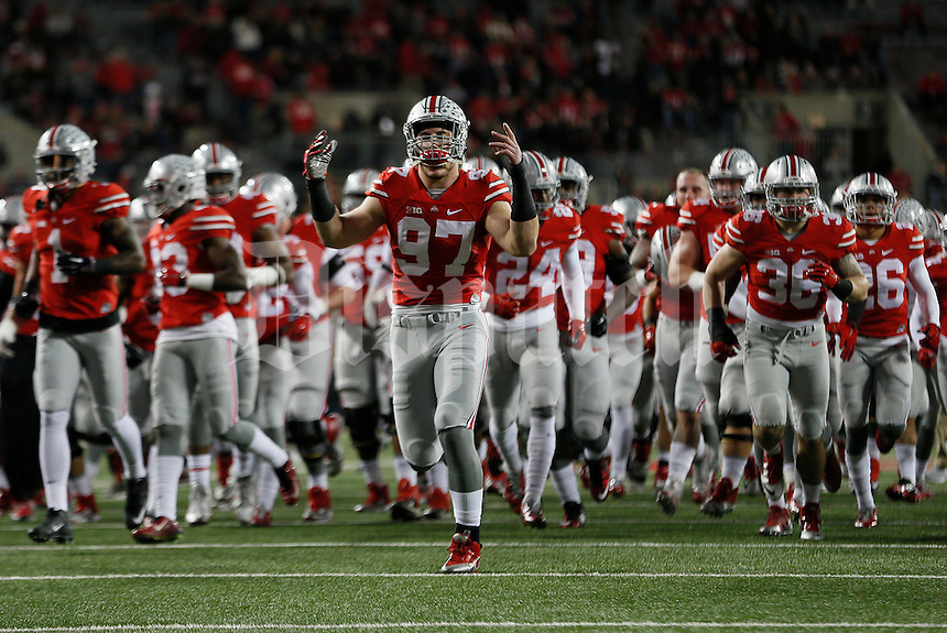 Ohio State Buckeyes defensive lineman Joey Bosa (97) hypes the crowd before the college football game between the Ohio State Buckeyes and the Minnesota Golden Gophers at Ohio Stadium in Columbus, Saturday night, November 7, 2015. The Ohio State Buckeyes defeated the Minnesota Golden Gophers 28 - 14. (The Columbus Dispatch / Eamon Queeney)
