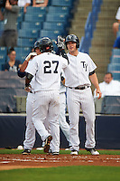 Tampa Yankees third baseman Miguel Andujar (27) high fives Austin Aune (21) after hitting a home run during a game against the Bradenton Marauders on April 11, 2016 at George M. Steinbrenner Field in Tampa, Florida.  Tampa defeated Bradenton 5-2.  (Mike Janes/Four Seam Images)