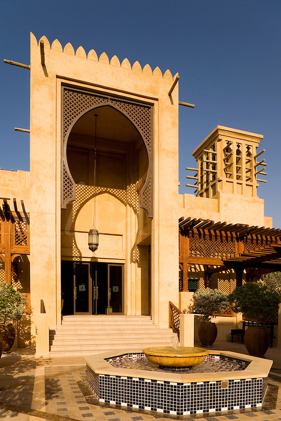 Dubai.  Grand Arab style entry to Madinat Jumeirah, shopping mall and souk, with wind tower and fountain..