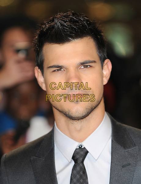 Taylor Lautner .'The Twilight Saga: Breaking Dawn - Part 1' UK film premiere at Westfield Stratford City, London, England..16th November 2011.headshot portrait black grey gray stubble facial hair  .CAP/BEL.©Tom Belcher/Capital Pictures.