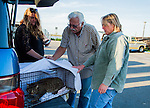 Susan Smith, Ray Zeeb, and Julie Linford prepare to return a previous trapped cat that has now been spayed/neutered and vaccinated to its' outside home area in Antioch, California, on Saturday, March 22, 2014.  Smith runs Rivertown Cats and volunteers for H.A.R.P., Zeeb volunteers for H.A.R.P. (Homeless Animal Response Program) and Linford runs Outcast Cat Help of Martinez.  Photo/Victoria Sheridan