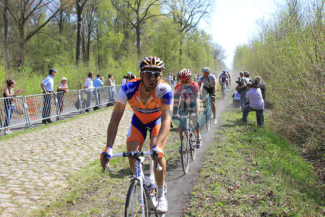 Riders race through the Forest of Arenberg on Pave Section 16 during the 109th edition of the Paris-Roubaix cycle race, 10th April 2011 (Photo by Eoin Clarke/NEWSFILE)