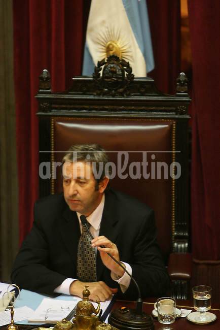Argentina's Vice president Julio Cobos attends a legislative session in Buenos Aires, Wednesday, July 16, 2008. Cobos cast the tie-breaking vote early Thursday morning in a session that saw major defections from Argentinean President Cristina Fernandez's ruling coalition, representing a severe blow to her presidency. Fernandez is facing the most critical test to her 7-month-old tenure after the country's Senate rejected a package of export taxes she had pegged her reputation to.