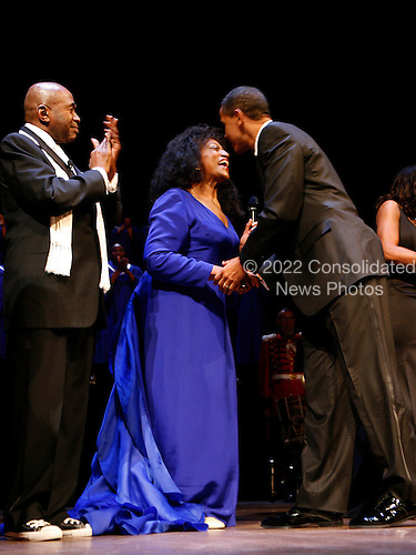 Washington, DC - February 11, 2009 -- United States President Barack Obama greets Opera Singer Jessye Norman while Ben Veeren applauds at the Ford's Theater reopening celebration, Washington, DC, Wednesday, February 11, 2009. Abraham Lincoln was shot at Ford's Theater on the evening of April 14, 1865.  The theater underwent an 18 month renovation..Credit: Aude Guerrucci - Pool via CNP