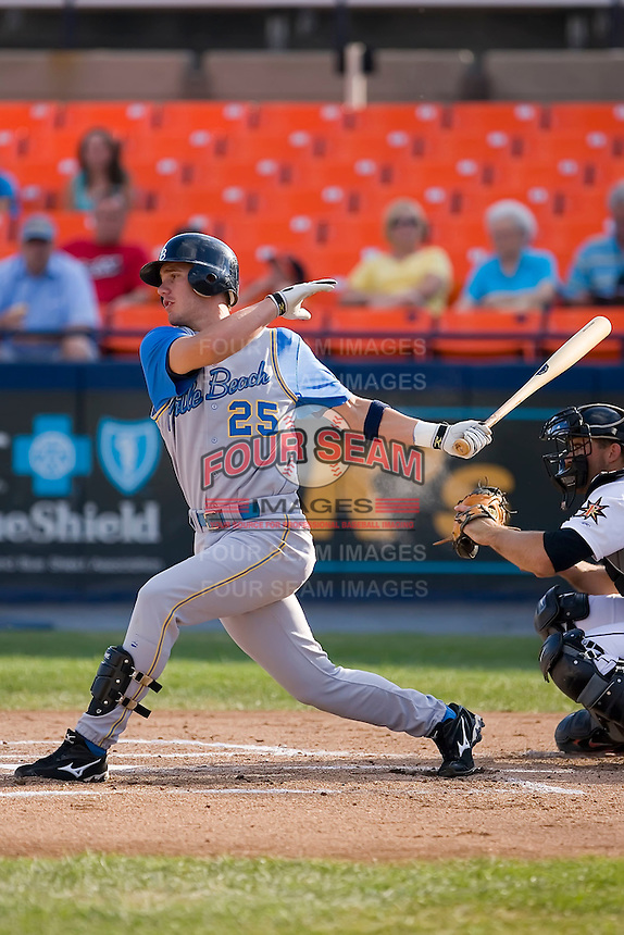 Jon Mark Owings (25) of the Myrtle Beach Pelicans follows through on his swing at Harry Grove Stadium in Frederick, MD, Monday July 14, 2008. (Photo by Brian Westerholt / Four Seam Images)