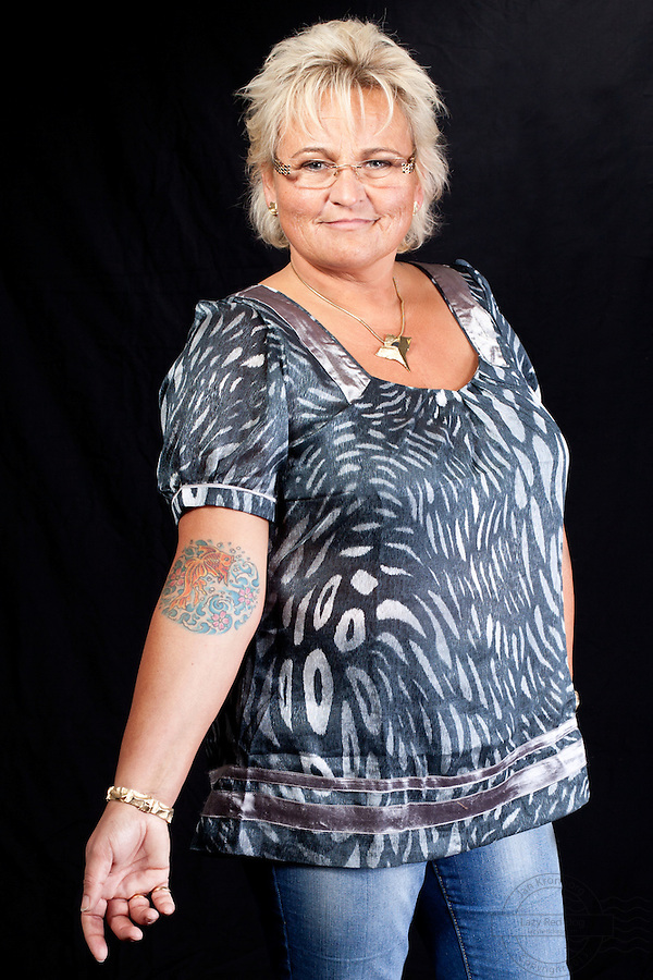 Danish woman with koifish tattoo on right arm.<br /> From the Kolding Tattoo Convention, Denmark