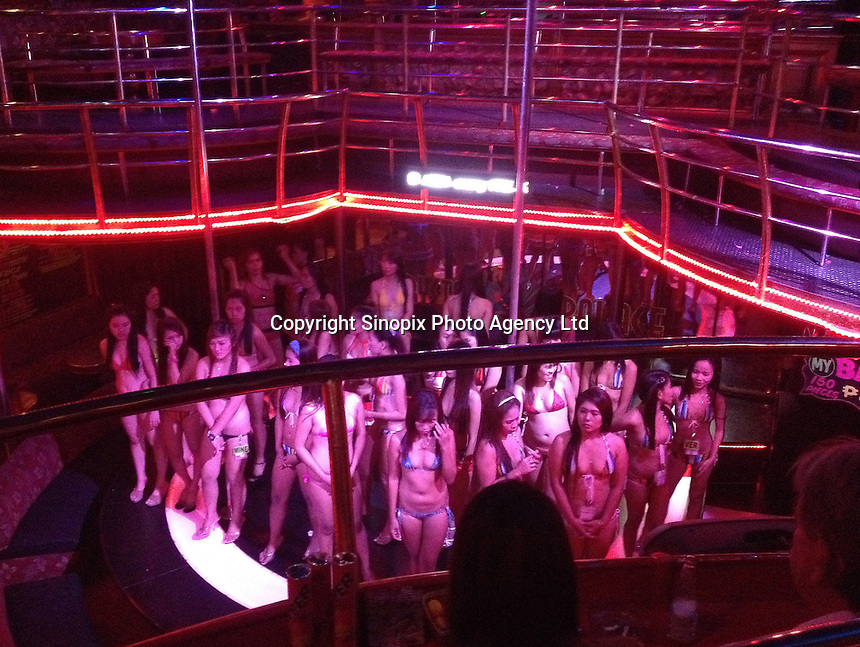 Prostitutes in skimpy bikinis are seen on stage in a girly bar in Angeles City, Republic of the Philippines, 08 November 2014. The 'sin city', which sprung up on the fringes of a US Air Force base during the Vietnam war, has a reputation for cheap sex, and was a favourite destination for alleged murderer Rurik Jutting, who used to fly to Angeles City from Hong Kong for debauched weekends. The British banker is currently on remand at a secure facility in Hong Kong for allegedly murdering two Indonesian prostitutes in his flat whilst high on alcohol and cocaine.