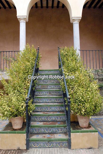 Tiled steps in a patio at El Alcazar in Seville, Spain.