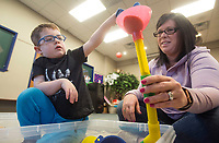 NWA Democrat-Gazette/BEN GOFF @NWABENGOFF<br /> Braxton Strode, 4, and mother Jaylene Strode of Rogers play in the sand Wednesday, Feb. 7, 2018, during a 'Hands On!' sensory program for ages 0-12 at the Rogers Public Library. The program offered a variety of toys and materials for children to explore and make crafts.