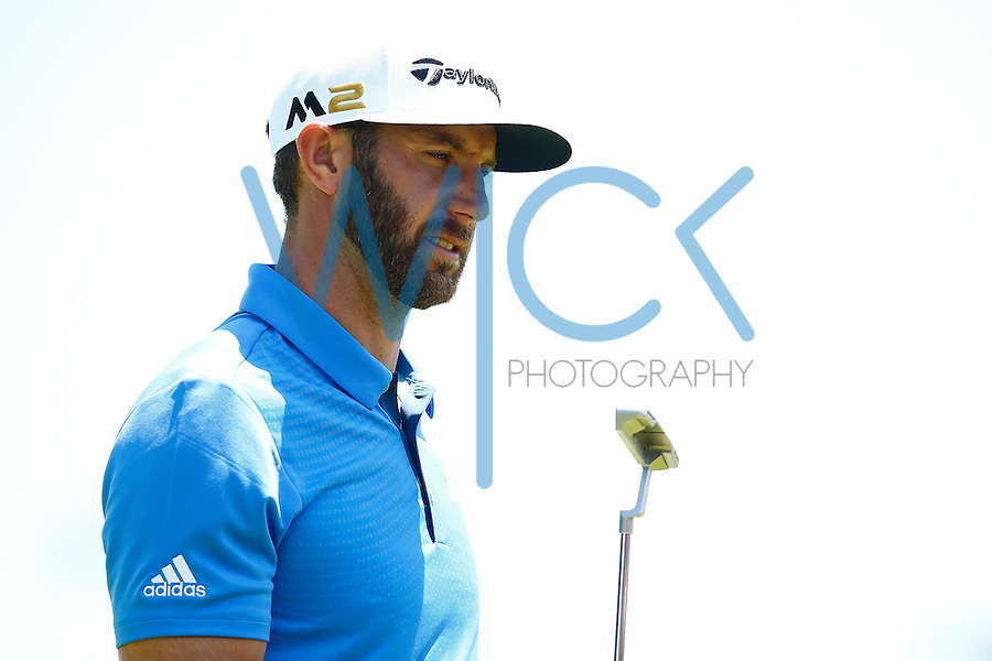 Dustin Johnson reacts after putting on the 16th green during the 2016 U.S. Open in Oakmont, Pennsylvania on June 17, 2016. (Photo by Jared Wickerham / DKPS)