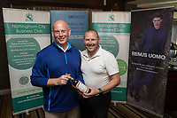 NCBC President Ian Roberts hands over the Nearest the Pin 12th hole prize of Jamieson Whiskey donated by Jamieson Christie to Paul Macmillan of Gas Container Services