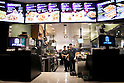 Staff of the new Taco Bell branch start to work for first time during the pre-opening event for the restaurant's first Japanese store located in Tokyo's Shibuya district, on April 20, 2015, Japan. The store includes Japan specific dishes like shrimp and avocado burrito and taco rice on its menu. It will open to the public on April 21st. The American Tex-Mex fast food restaurant has signed a franchise agreement with Asrapport Dining Co., Ltd. to operate Taco Bell branches in Japan. (Photo by Rodrigo Reyes Marin/AFLO)