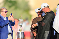 Keith Pelley CEO European Tour taking a picture of Lee Westwood (ENG) on the winners platform during the final  round of the Abu Dhabi HSBC Championship, Abu Dhabi Golf Club, Abu Dhabi,  United Arab Emirates. 19/01/2020<br /> Picture: Fran Caffrey | Golffile<br /> <br /> <br /> All photo usage must carry mandatory copyright credit (© Golffile | Fran Caffrey)