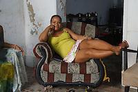 cuban joy of life: woman relaxing at home