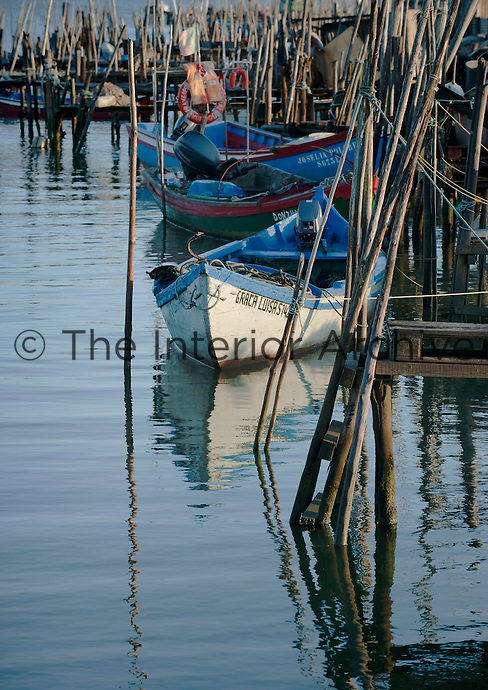 The wooden quays in the small port of Carrasqueira are cluttered with boats, testimony that fishing is still an important industry along the Portuguese coast