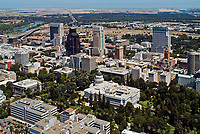 aerial photograph of the California State Capitol building, Sacramento, California and the surrounding Capital Park and downtown Sacramento skyline of office buildings