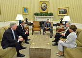 United States President Barack Obama, center, holds a meeting with Congressional leaders (L-R) U.S. Senate Minority Leader Mitch McConnell (Republican of Kentucky), Speaker of the U.S. House of Representatives John Boehner (Republican of Ohio), U.S. Senate Majority Leader Harry Reid (Democrat of Nevada) and U.S. House Minority Leader Nancy Pelosi (Democrat of California) in the Oval Office at the White House, June 18, 2014, in Washington, DC. The meeting was for briefings on the deteriorating situation in Iraq, as the militants of the Islamic State of Iraq and Syria continue consuming Iraqi territory on the road to Baghdad.    <br /> Credit: Mike Theiler / Pool via CNP