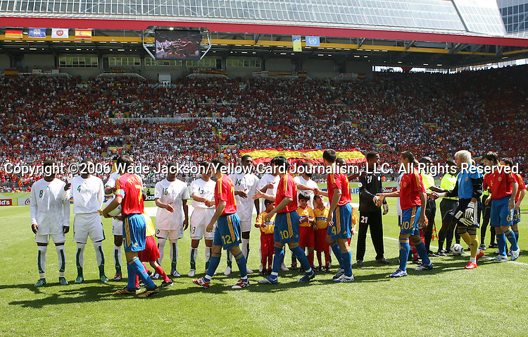 23 June 2006: Spain's starters (red, blue) shake hands with Saudi Arabia's starters (white) before the game. Saudi Arabia lost to Spain at Fritz-Walter Stadion in Kaiserslautern, Germany in match 47, a Group H first round game, of the 2006 FIFA World Cup.