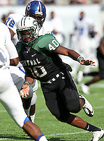 Miami Central Rockets linebacker Devin Rollins #40 pursues a play during the first quarter of the Florida High School Athletic Association 6A Championship Game at Florida's Citrus Bowl on December 17, 2011 in Orlando, Florida.  The score at halftime is Armwood 16 - Miami Central 14.  (Mike Janes/Four Seam Images)