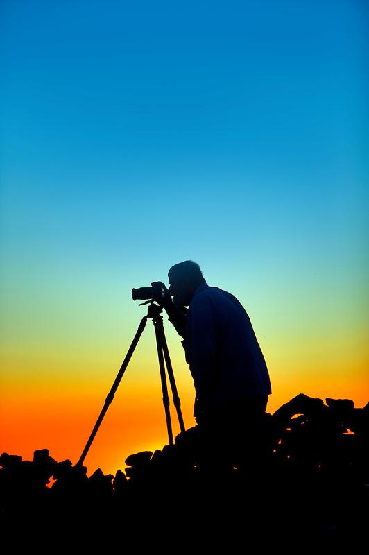 Photographer silhouette on rim of Steen Mountain. Oregon