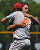 Reiss Knehr of St. Dominic High School, right (not wearing cap), congratulates Chaminade No. 10 Salvatore Fradella after the Flyers won the NSCHSAA varsity baseball championship at New York Institute of Technology on Monday, May 25, 2015.<br /> <br /> James Escher
