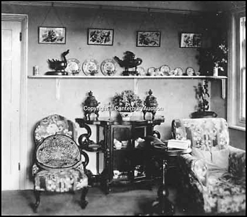 BNPS.co.uk (01202) 558833Pic: CanterburyAuction/BNPS<br /> <br /> Captain Harry Lewis Evans front room with both elephant censers and the Western Zhou water vessel pictured central.<br /> <br /> A Chinese relic looted from the Summer Palace by a British army officer 158 years ago has sold for more than half a million pounds after it was found in the attic of an unassuming English house.<br /> <br /> The 3,500 year old sacred Chinese bronze water vessel is one of seven known to exist, with five in museums, but Chinese officials said the stolen antiquity should be returned to China.<br /> <br /> The rare item was taken by Captain Harry Lewis Evans when the British and French arrived at the Emperor's Summer Palace in Peking - now Beijing - during the Second Opium War.<br /> <br /> Capt Evans wrote letters home describing the mystical palace and the looting of its treasures that took place in 1860.<br /> <br /> Along with the rare Tiger Ying, three other Chinese bronzes sold which brought the total to £549,320 including premiums.<br /> <br /> China's State Administration of Cultural Heritage is believed to have said it was looking into the auction and opposed the sale and purchase of illegal cultural relics.