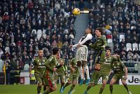 6th January 2020; Allianz Stadium, Turin, Italy; Serie A Football, Juventus versus Cagliari; Alex Sandro of Juventus and Luca Pellegrini of Cagliari contest for a header - Editorial Use