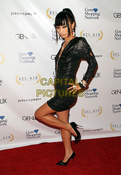 BAI LING .1st Annual Film Festival held at a Bel Air Private Estate, Bel Air, California, USA, 14 November 2008..full length black tights long sleeved cut out circle necklaces bracelets shoes  dress hand on hip leg knee up posing .CAP/ADM/KB.©Kevan Brooks/Admedia/Capital PIctures