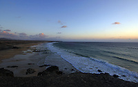 Waves on the beach at dusk, Playa del Castillo, El Cotillo, Fuerteventura, Canary Islands, Spain.