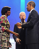 Former United States President Bill Clinton (C) and US President Barack Obama (R) greet US First Lady Michelle Obama (L) at the Clinton Global Initiative (CGI) in New York, New York, USA, Thursday, 23 September 2010. President Obama joined sixty-four current and former heads of state in attending the sixth annual meeting of the CGI.  The commitment of CGI members has improved the lives of more than 220 million people in 170 countries, according to President Bill Clinton.  The 2010 meeting features a session on 'Peace and Beyond in the Middle East'.  .Credit: Michael Reynolds - Pool via CNP