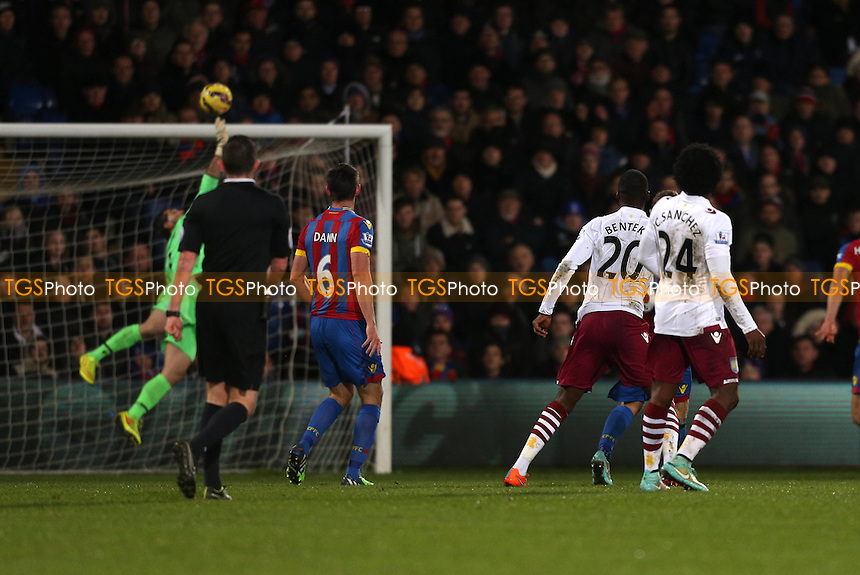 Christian Benteke of Aston Villa tests Julian Speroni of Crystal Palace with a shot from outside the box. - Crystal Palace vs Aston Villa - Barclays Premier League Football at Selhurst Park, London - 02/12/14 - MANDATORY CREDIT: Simon Roe/TGSPHOTO - Self billing applies where appropriate - contact@tgsphoto.co.uk - NO UNPAID USE