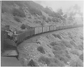 D&amp;RGW westbound Marshall Pass freight climbing Marshall Pass.  The pusher engine is just in front of the caboose but the other engines are out of sight.<br /> D&amp;RGW  Marshall Pass, CO  8/24/1948