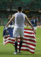 Claudio Reyna holds the American flag after the game. The USA lost to Germany 1-0 in the Quarterfinals of the FIFA World Cup 2002 in South Korea on June 21, 2002.