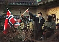 Neo-nazis taunt opposing demonstrators during a confrontation in Oslo, Norway 1995...1995.02.11 Nynazister roper og gestikulerer til demonstranter fra venstresiden under en konfrontasjon i Oslo.