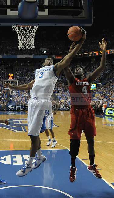 Kentucky's Terrence Jones (3) gets a strong rebound during the first half of the University of Kentucky Basketball game against Louisville at Rupp Arena in Lexington, Ky., on 12/31/11. UK led the game at half 36-33. Photo by Mike Weaver | Staff