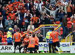 Dundee United v St Johnstone...24.08.13      SPFL<br /> The Dundee United players mob David Goodwillie after he scored the second goal<br /> Picture by Graeme Hart.<br /> Copyright Perthshire Picture Agency<br /> Tel: 01738 623350  Mobile: 07990 594431