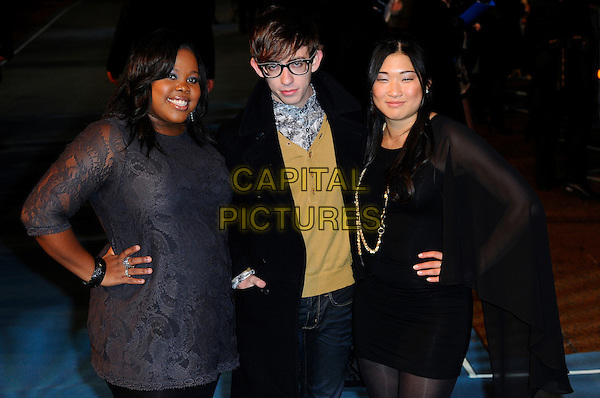 "AMBER RILEY, KEVIN McHALE & JENNA USHKOWITZ of GLEE.At the ""Tron: Legacy"" UK Film Premiere, Empire cinema, Leicester Square, London, England, UK, .December 5th 2010..half length cast grey gray lace hand on hip dress black sheer mesh coat glasses .CAP/CAS.©Bob Cass/Capital Pictures."