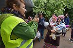 A Czech volunteer uses her phone to take a photo of an Iraqi refugee woman and her 18-month old daughter, Mahdi, as they approach the border into Croatia near the Serbian village of Berkasovo. Hundreds of thousands of refugees and migrants from Syria, Iraq and other countries have flowed through Serbia in 2015, on their way to western Europe.