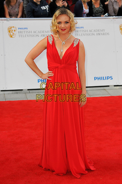 CHARLIE BROOKS .Attending the Philips British Academy Television Awards, Grosvenor house Hotel, Park Lane, London, England, UK, May 22nd 2011..arrivals TV Baftas Bafta full length red dress hand on hip long maxi  cleavage silver shoulders sleeveless .CAP/CAS.©Bob Cass/Capital Pictures.