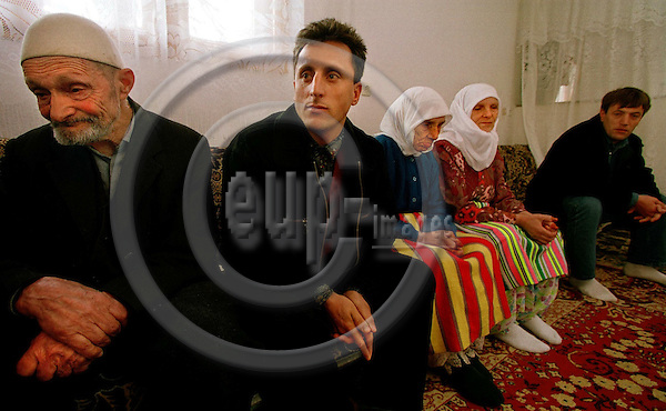 MACEDONIA/TETOVO 31, MARCH 2001--Albanian refugees,  (left) Quamile, Artami,  Miritvet with her daughter Ruhide RAMACANI and Ramadfaqn.  Artami and Ramadfaqn came from Italy to support their family. -- PHOTO: JUHA ROININEN / EUP-IMAGES