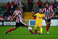 Lincoln City's Matt Rhead vies for possession with Morecambe's Michael Rose<br /> <br /> Photographer Andrew Vaughan/CameraSport<br /> <br /> The EFL Sky Bet League Two - Lincoln City v Morecambe - Saturday August 12th 2017 - Sincil Bank - Lincoln<br /> <br /> World Copyright &copy; 2017 CameraSport. All rights reserved. 43 Linden Ave. Countesthorpe. Leicester. England. LE8 5PG - Tel: +44 (0) 116 277 4147 - admin@camerasport.com - www.camerasport.com