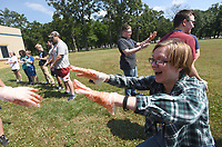 NWA Democrat-Gazette/FLIP PUTTHOFF <br /> HELP IS ON THE WAY<br /> Hazen Roberts (right) laughs with classmates Wednesday June 6 2018 after students got fake blood applied to their protective gloves during a wilderness first aid class held at Rogers New Tech High School. Middle school and high school students learned first aid skills they can use to help people who become sick or injured while hiking, camping, or boating. The class runs through Saturday.