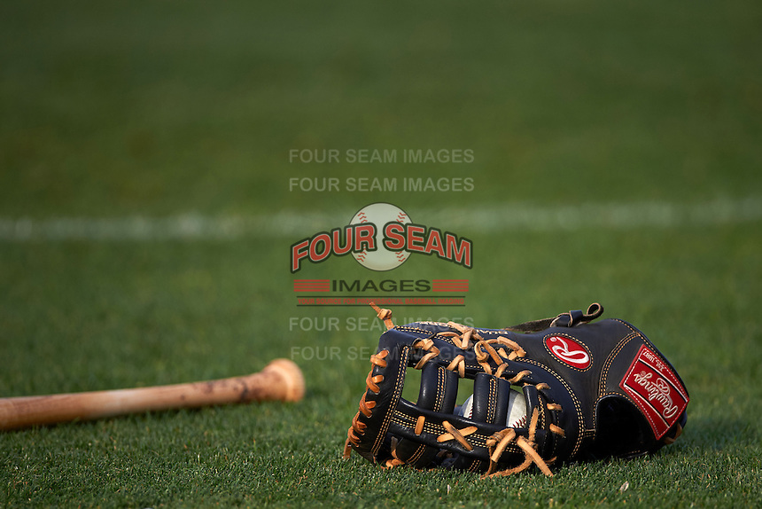 Rawlings baseball glove and ball sit in the outfield grass before a game between the Hagerstown Suns and Lexington Legends on May 22, 2015 at Whitaker Bank Ballpark in Lexington, Kentucky.  Lexington defeated Hagerstown 5-1.  (Mike Janes/Four Seam Images)