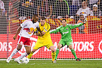 Columbus Crew goalkeeper Andy Gruenebaum (30) watches as Josh Williams (3) defends Thierry Henry (14) of the New York Red Bulls. The New York Red Bulls defeated the Columbus Crew 3-1 during a Major League Soccer (MLS) match at Red Bull Arena in Harrison, NJ, on September 15, 2012.