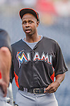 20 September 2013: Miami Marlins outfielder Juan Pierre chats with teammates prior to a game against the Washington Nationals at Nationals Park in Washington, DC. The Nationals defeated the Marlins 8-0 to take the second game of their 4-game series. Mandatory Credit: Ed Wolfstein Photo *** RAW (NEF) Image File Available ***