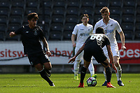 SWANSEA, WALES - MARCH 25: Jay Fulton of Swansea City is challenged by Odar Govea of Porto during the Premier League International Cup Semi Final match between Swansea City and Porto at The Liberty Stadium on March 25, 2017 in Swansea, Wales. (Photo by Athena Pictures)
