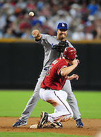 Jul 20, 2008; Phoenix, AZ, USA; Los Angeles Dodgers shortstop Jeff Kent throws to first base to complete a double play after forcing out Arizona Diamondbacks base runner Stephen Drew at Chase Field. Mandatory Credit: Mark J. Rebilas-